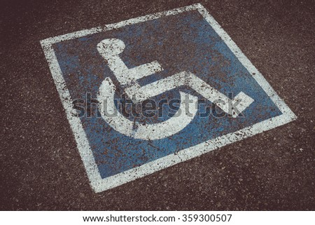 Vintage tone of Sign disabled, detail of a signal in a parking support - stock photo