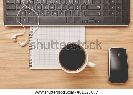 Vintage tone of Top view. Table with Keyboard, headphones and coffee cup - stock photo