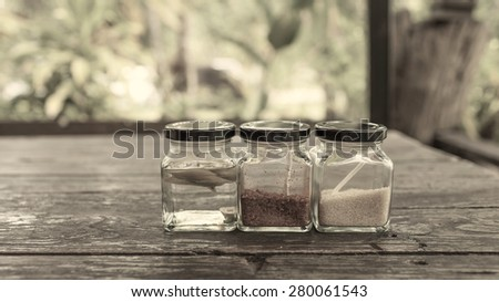 Vintage tone Thai condiment set in the glass bottle with space on the background - stock photo