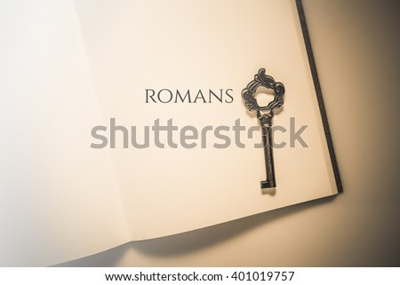 Vintage tone the bible book of Romans - stock photo