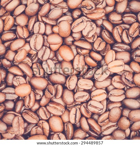 Vintage toned coffee beans for texture or background, overhead view - stock photo