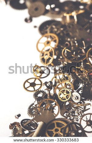 Vintage toned image of gearwheels, parts from old clock - stock photo