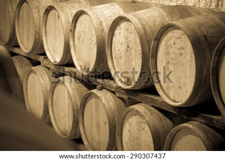 Vintage toned photo  of  winery cellar with  wooden barrels  - stock photo