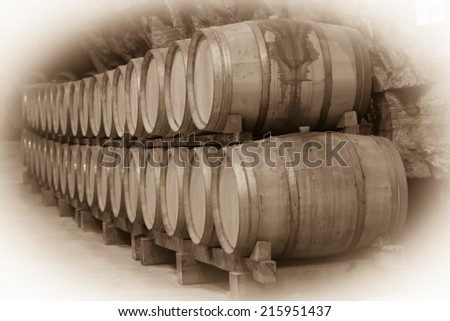 Vintage toned photo  of  winery  with  wooden barrels  - stock photo