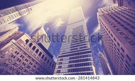 Vintage toned picture of skyscrapers in Lower Manhattan, looking up at sky, New York City, USA. - stock photo