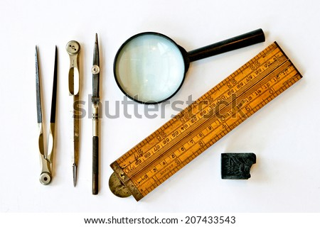 Vintage tools for measurement, drawing, draftsmanship, and graphical works. Isolated on white background.   - stock photo
