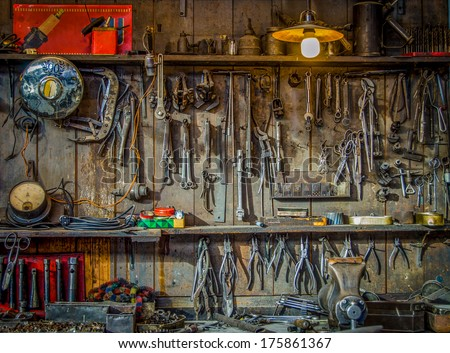 Vintage Tools Hanging On A Wall In A Tool Shed Or Workshop - stock photo