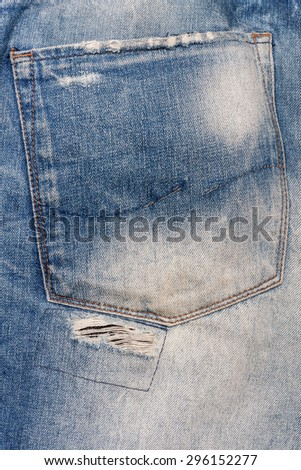 vintage torn denim jeans texture with space for text. - stock photo