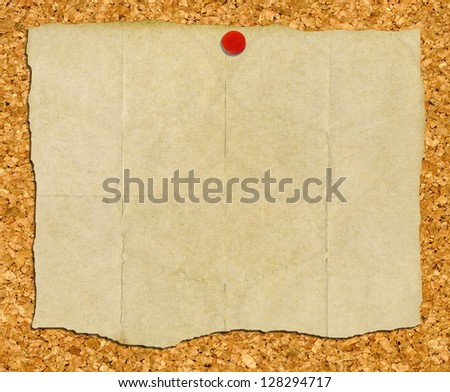 Vintage torn paper stuck to a cork noticeboard. - stock photo