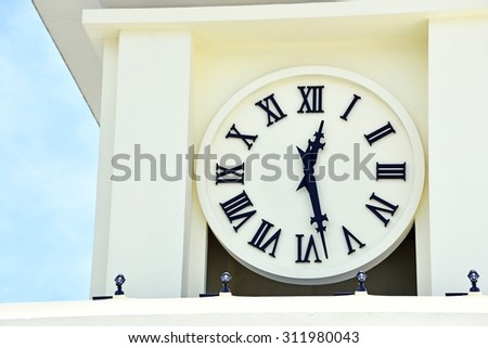 Vintage tower clock with Roman numerals - stock photo