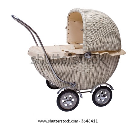 Vintage toy doll buggy isolated on white background - stock photo