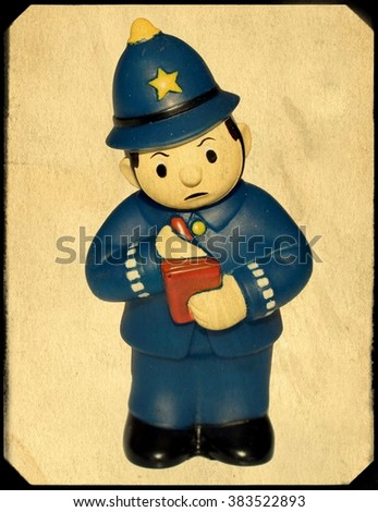 Vintage Toy Policeman in Frame - stock photo