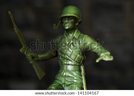 Vintage toy soldier with dramatic low key lighting effect.  Macro with shallow dof. - stock photo