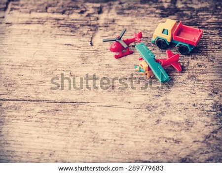 Vintage toy truck and blue car on wooden table background with copy space. - stock photo