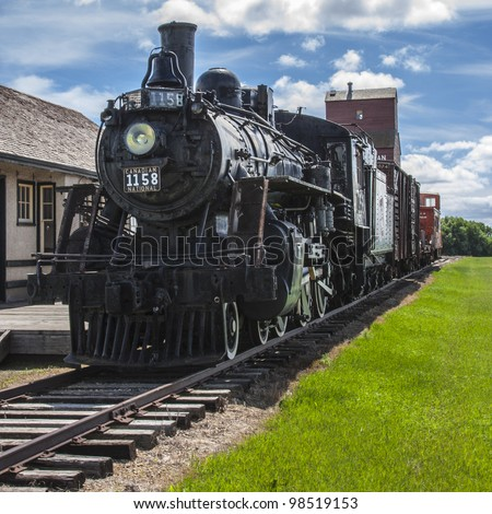 Vintage train station on the Canadian prairies. - stock photo