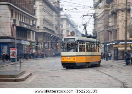 Vintage tram on the city street with motion blur, Milano, Italy  - stock photo