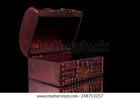 vintage treasure chest closeup on table - stock photo