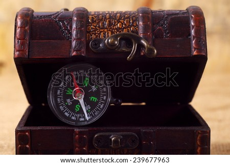 vintage treasure chest with compass - stock photo