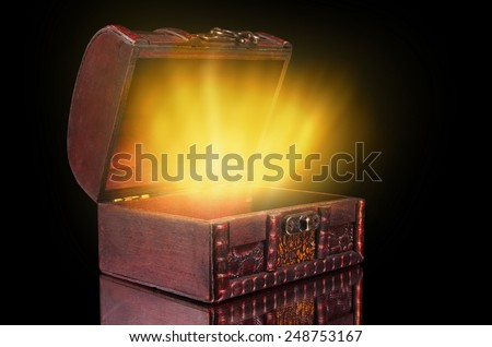vintage treasure chest with light - stock photo