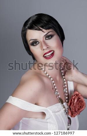 Vintage twenties woman wearing a flapper dress - stock photo