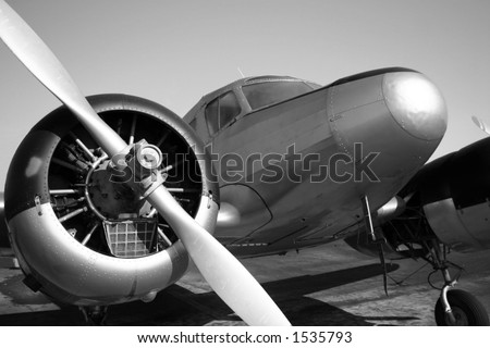 Vintage twin engine airplane in black and white - stock photo