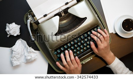 Vintage typewriter and blank sheet of paper, human hands - stock photo