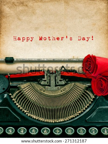 Vintage typewriter and red rose flowers. Aged textured grungy paper. Sample text Happy Mother's Day! - stock photo