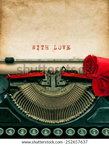 Vintage typewriter and red rose flowers. Aged textured grungy paper. Sample text With Love. Valentines Day concept - stock photo