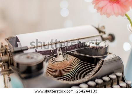 Vintage typewriter and spring flowers - stock photo