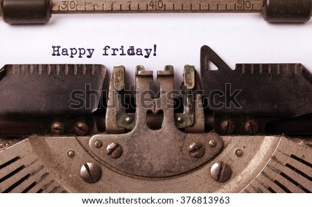 Vintage typewriter close-up - Happy friday, concept of motivation - stock photo