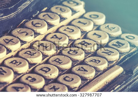 Vintage typewriter detail with stone carved keys photographed with shallow depth of field. Image cross processed for vintage look - stock photo