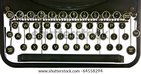 Vintage typewriter keyboard, backlit on white. Includes alphabet, numerals, shift key, backspacer, and tabulator. - stock photo