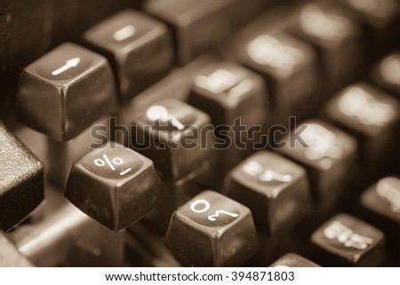 Vintage typewriter keyboard in sepia tone image - stock photo