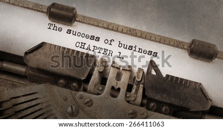 Vintage typewriter, old rusty and used, The succes of business, chapter 1 - stock photo