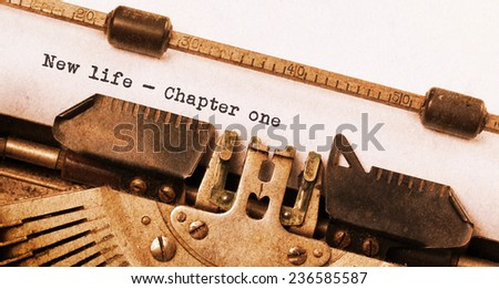 Vintage typewriter, old rusty, warm yellow filter, new life chapter 1 - stock photo
