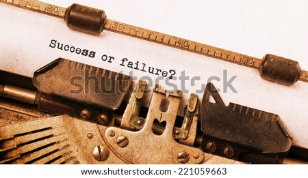 Vintage typewriter, old rusty, warm yellow filter - Success or failure - stock photo