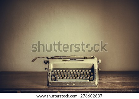 Vintage typewriter on table - stock photo