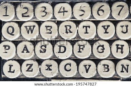 Vintage typewriter stone carved keys detail - stock photo