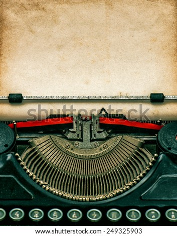 Vintage typewriter with aged textured grungy paper - stock photo