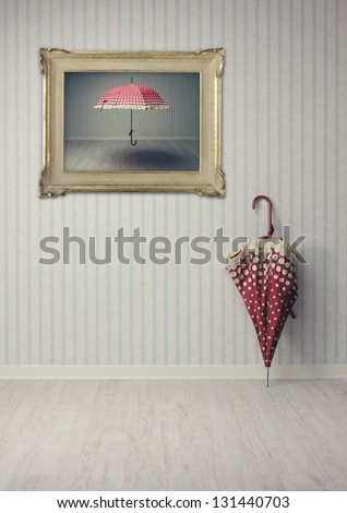 vintage umbrella in an empty room or art gallery - stock photo