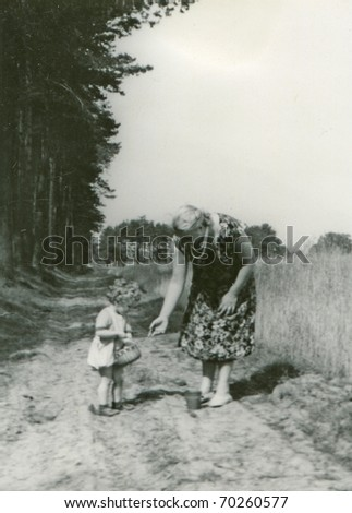 Vintage unretouched photo of mother and daughter - stock photo