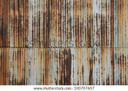 Vintage vertical corrugated metal wall. Rusty and well worn with nice patina. / Rusted, Vintage, Corrugated Metal / Great grunge surface for background or texture. - stock photo
