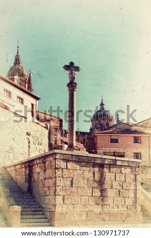 Vintage view to old big cross and Cathedral in Salamanca. Retro style photo. - stock photo