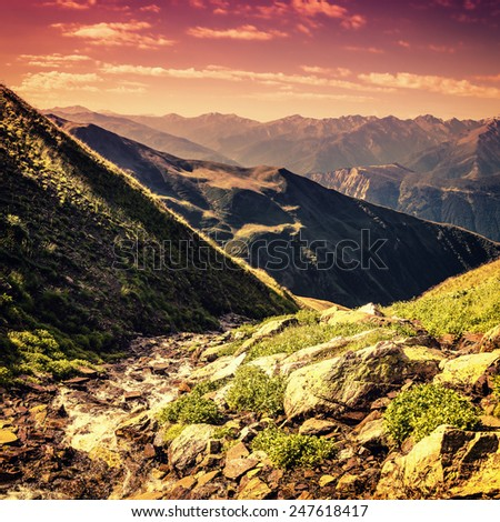 Vintage view with small stream in mountain - stock photo