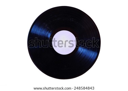 vintage vinyl disks hanging on the wall - stock photo