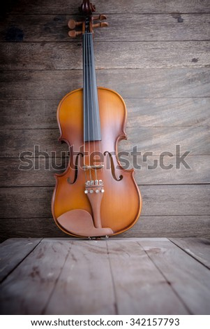 Vintage violin on wooden background - stock photo