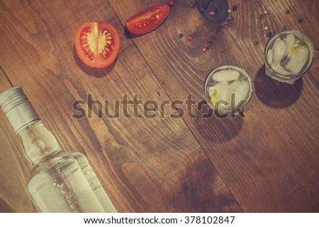 Vintage. Vodka, gin. tequila in a glass with ice  on a wooden table, a reflection. top view, closeup - stock photo