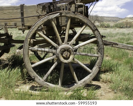 Vintage wagon wheel of the Old West - stock photo