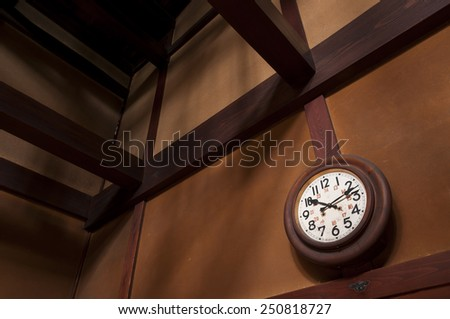 Vintage wall clock with pendulum - stock photo