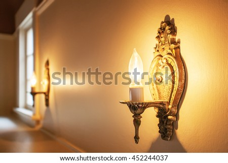 Vintage wall lamp close up on beige wall in empty  room.  - stock photo